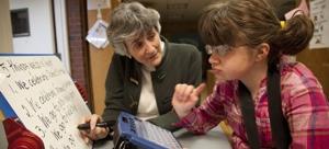 a student studies a teacher's large print list